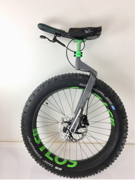 26er 85mm wide fat bike rim on Unicycle carbon rim with the green BTLOS sticker
